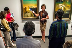 a docent leads a gallery tour