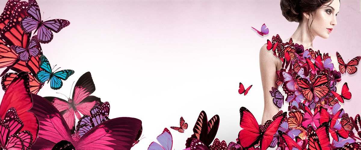 """Model in a dress made of butterflies with the caption """"Daring in Fashion""""."""