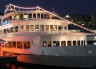 a dinner cruise ship at night