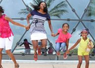 museum visitors jump for joy