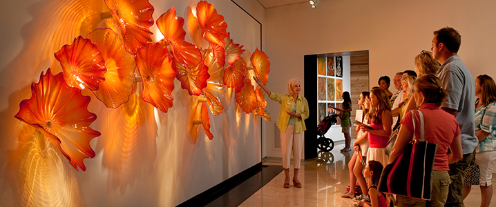visitors viewing a sculpture at the Chihuly Museum