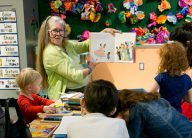 Miss Vickie reads stories to children