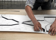 An artist working at Bleu Acier Print Gallery