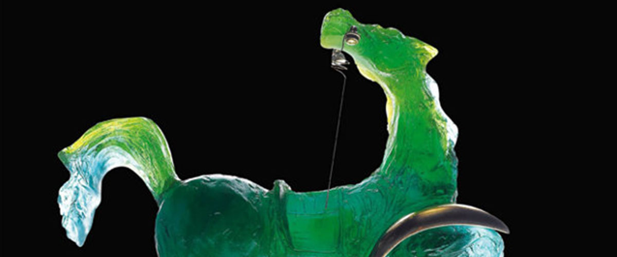Salvador Dali daum glass, a green horse with gold embellishment lifts front hoof and gazes backward