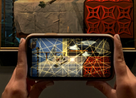 a smartphone using an app to look at a Dali painting