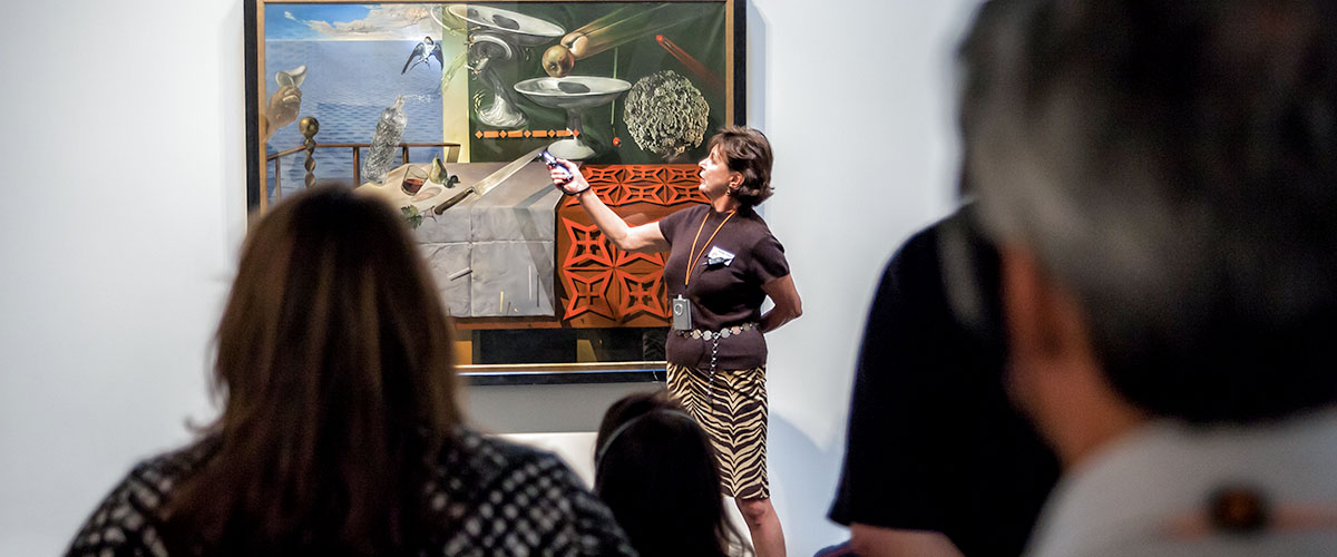Docent delivers tour in James Family Wing