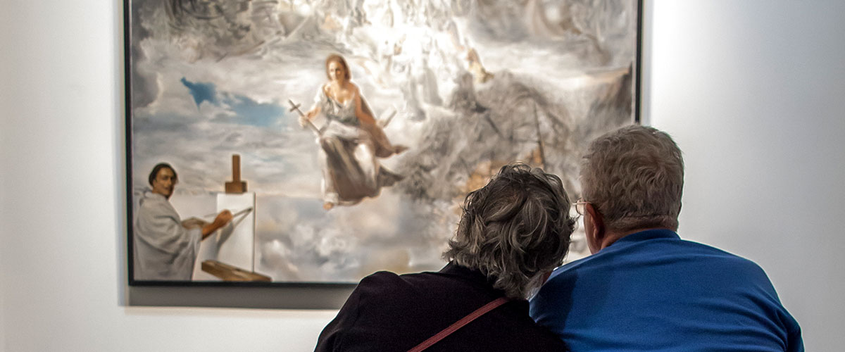 Couple Admires Salvador Dali's Ecumenical Council