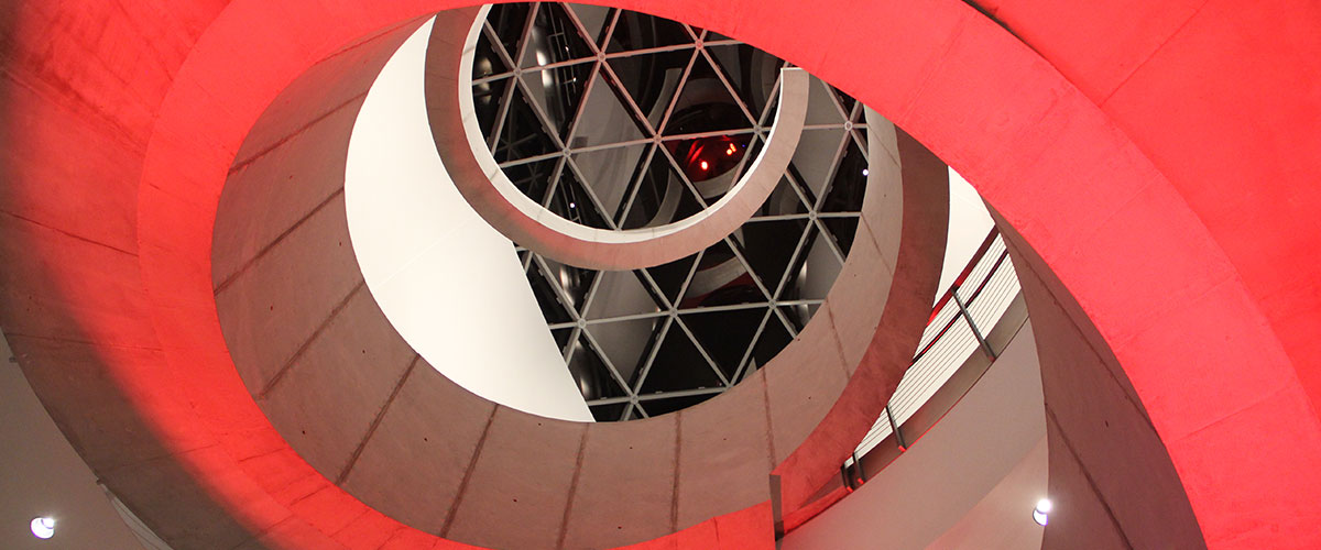 The Dali Museum helical staircase illuminated in red at night