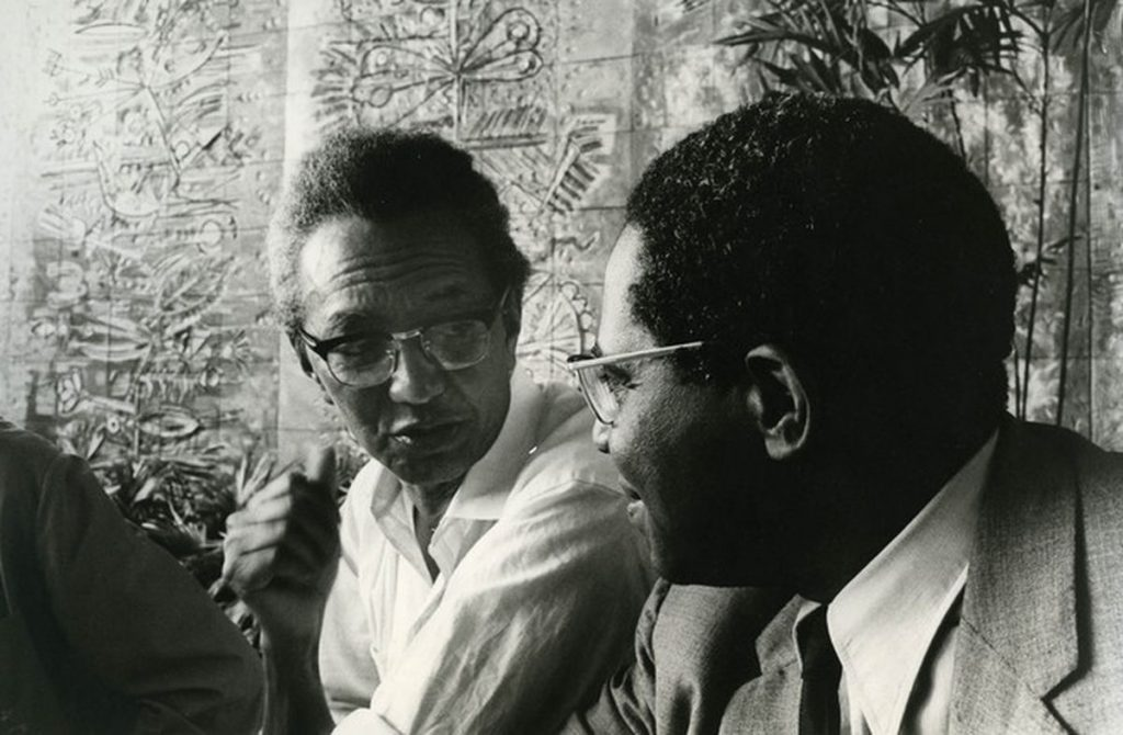 Wifredo Lam and Aime Cesaire in conversation.